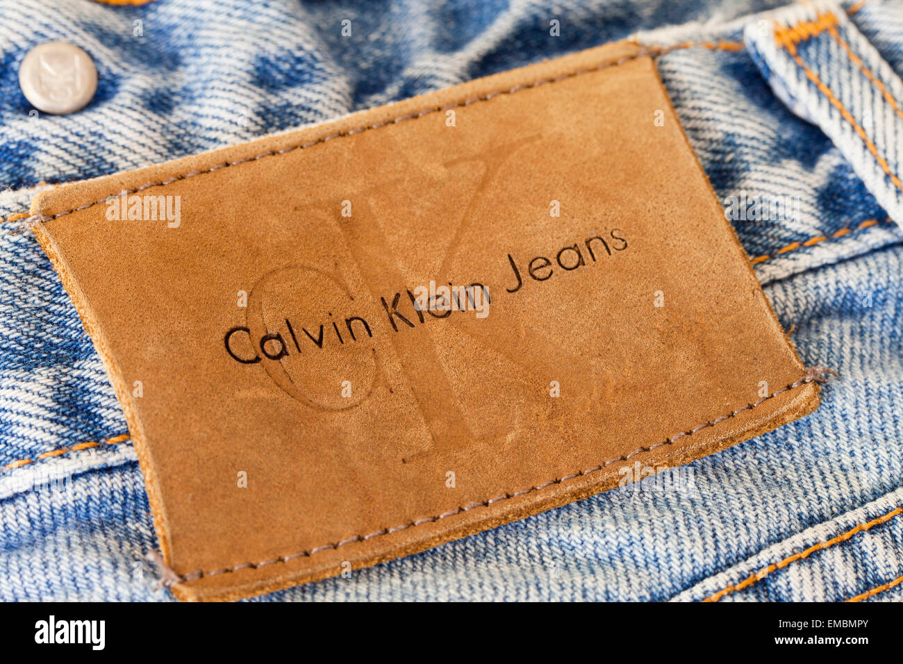 Branding patch on pair of Calvin Klein blue jeans - Stock Image