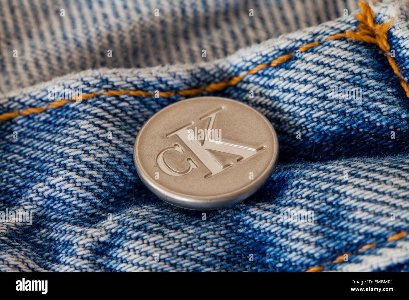 Calvin Klein blue jeans button - Stock Image