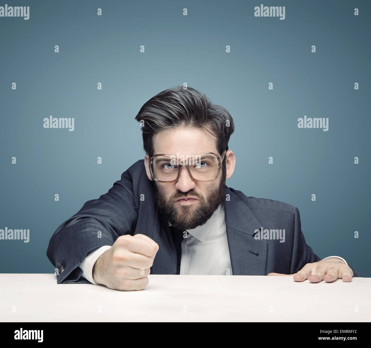 Young tough businessman ruling the company - Stock Image