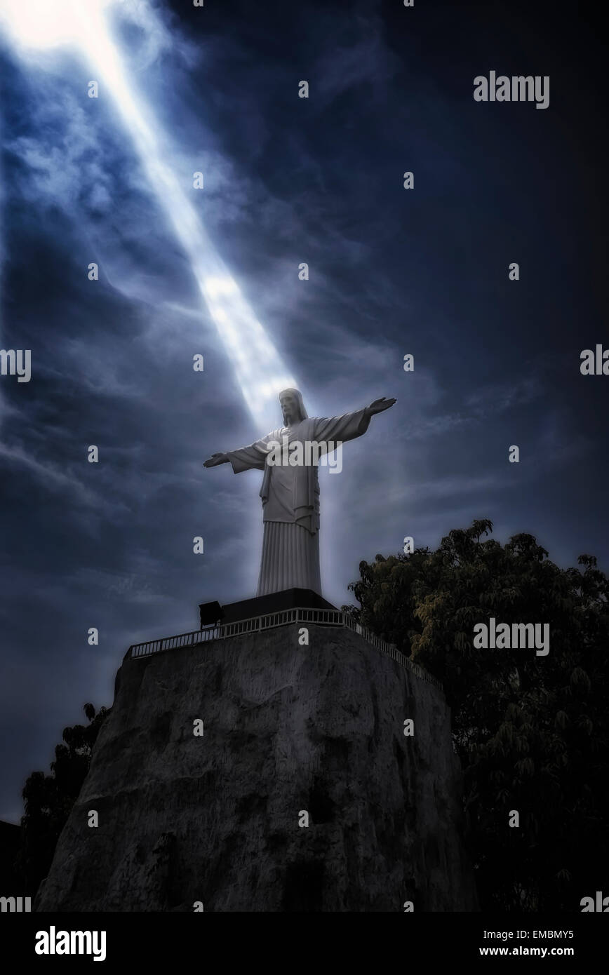 Beam of light cast on the figure of Christ the Redeemer. Concept of 'I am the Light' - Stock Image