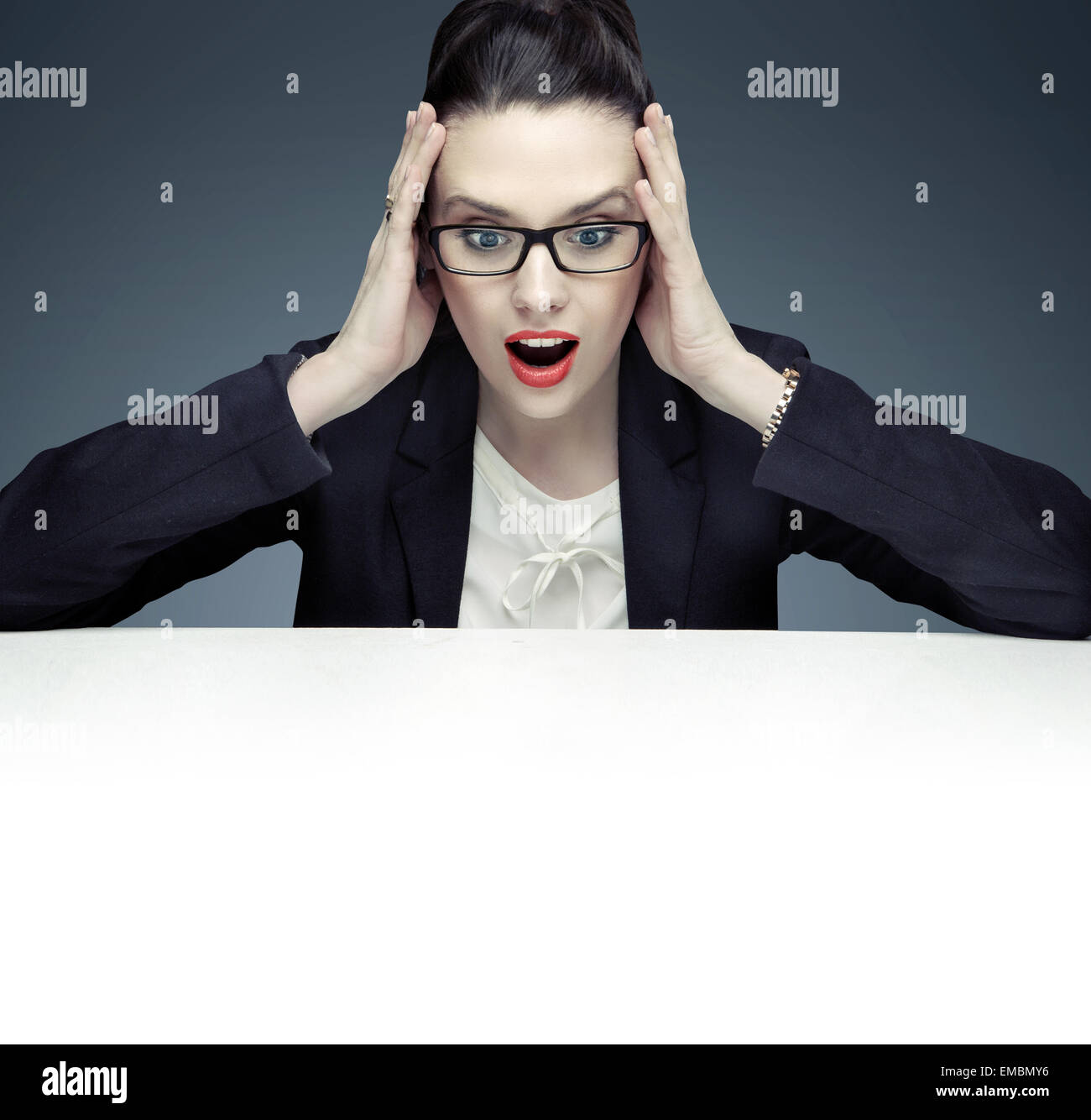 Totally surprised businesswoman staring at sth - Stock Image