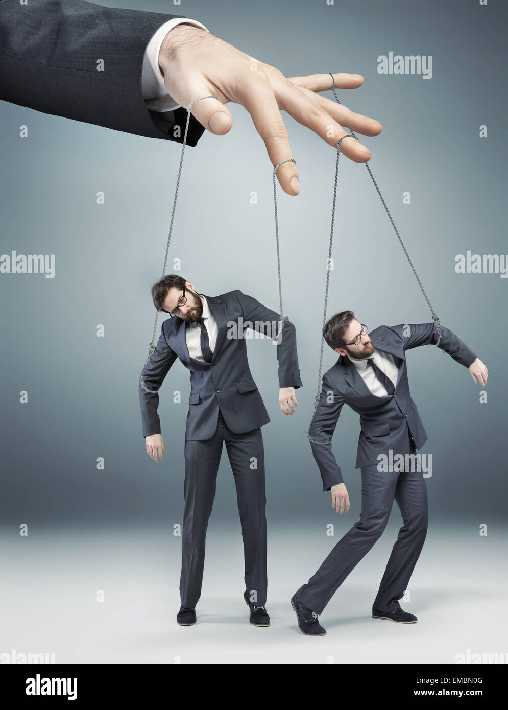 Conceptual picture of controlled employees - Stock Image
