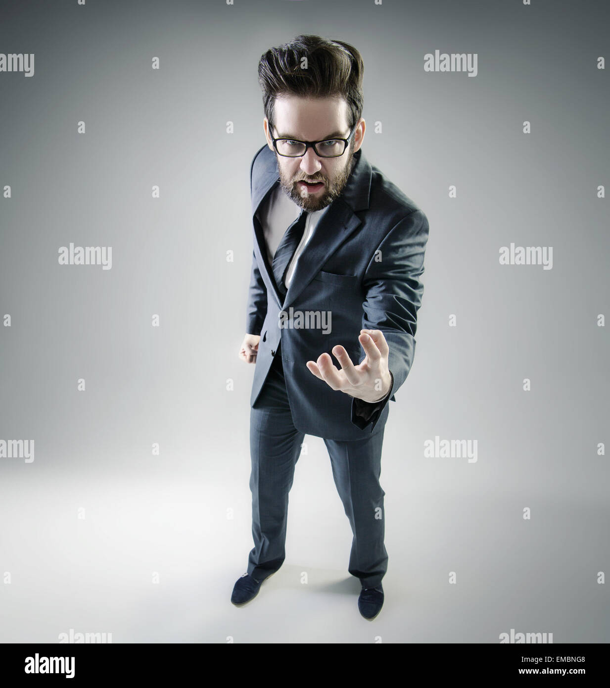 Angry businessman posing in elegant suit - Stock Image