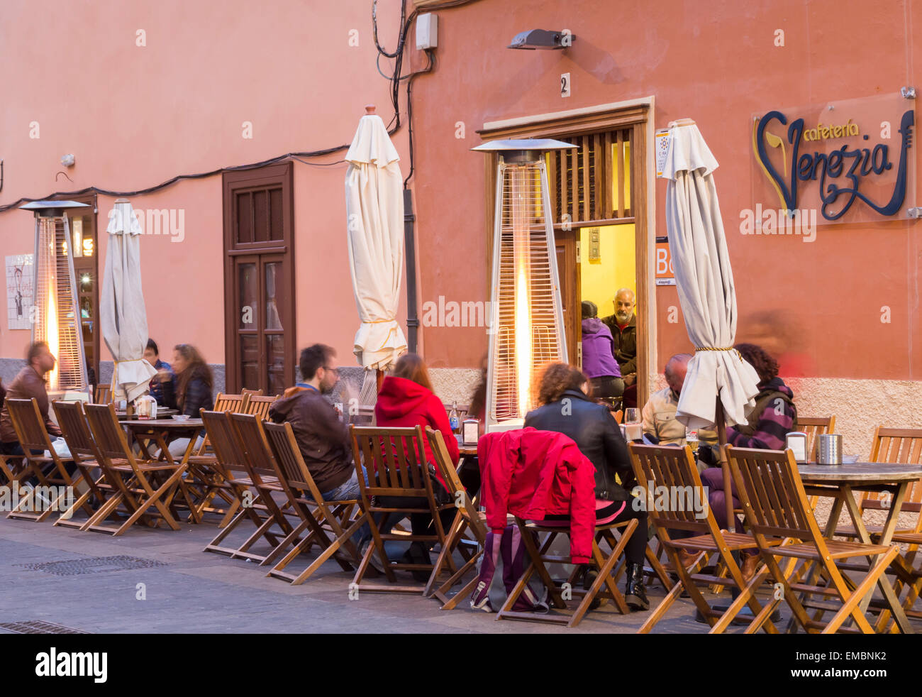 Patio heaters outside street bar at night in San Cristobal de La Laguna, Tenerife, Canary Islands, Spain - Stock Image