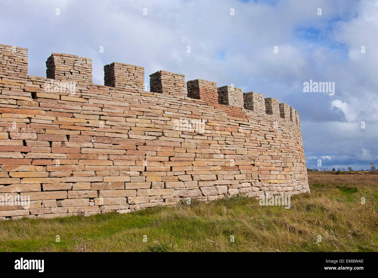 Defensive dry stone wall with crenellation of the Eketorp Castle, Iron Age fort in southeastern Öland, Sweden - Stock Image