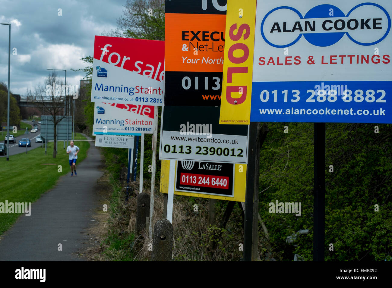 Row of estate agents signs for renting and houses for sale in Leeds West Yorkshire United KIngdom Stock Photo