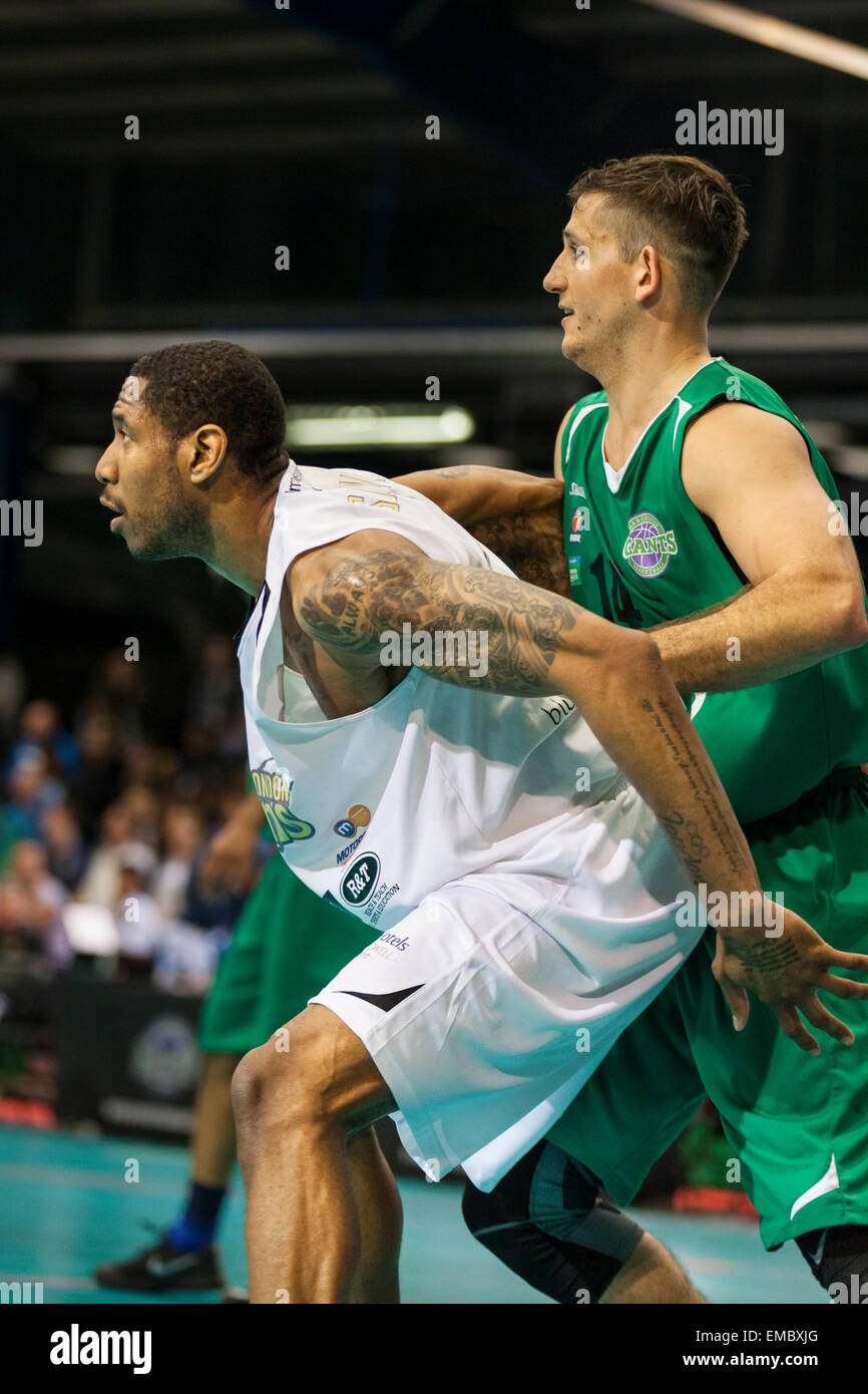 Manchester, UK. 19th April 2015. London Lions forward Andrew Sullivan defends against Manchester Giants' Rob Marsden Stock Photo