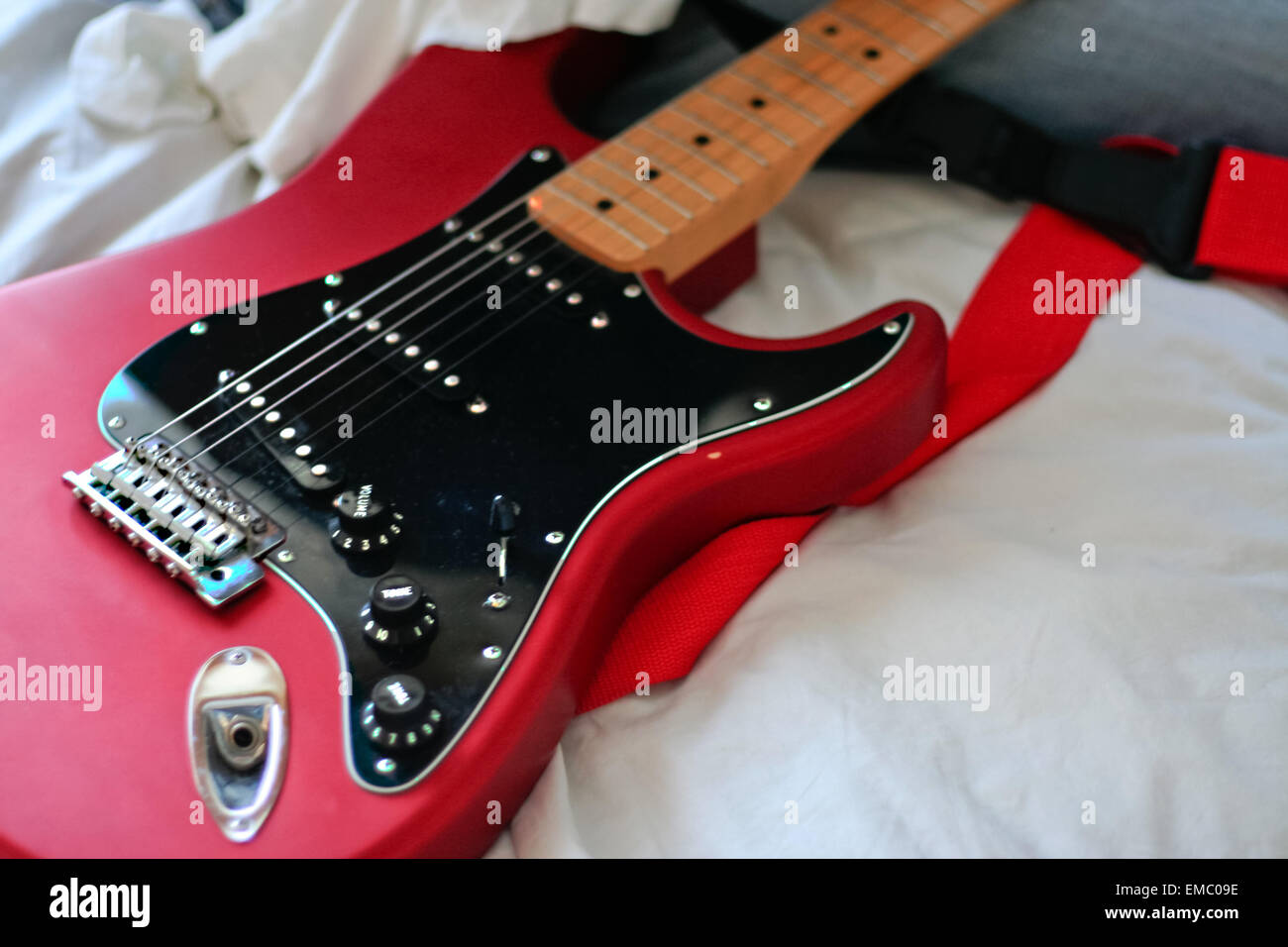 Unidentified Man Cleans His Electric Guitar Neck With A White Rag