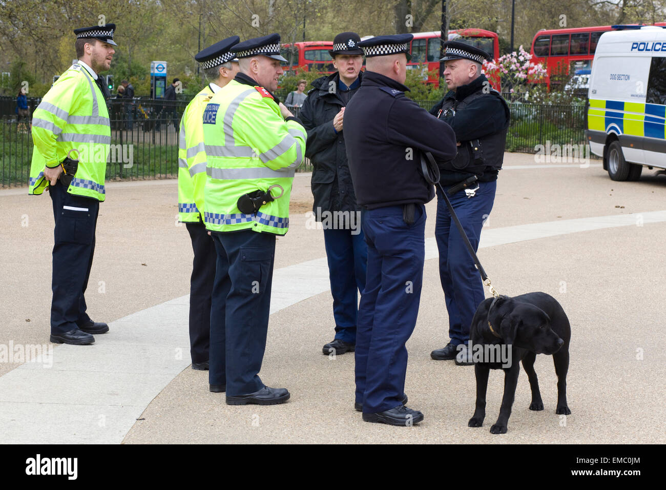 Police officers in Hyde Park London on Patrol Looking for people in Possession of Cannabis with a sniffer dog - Stock Image