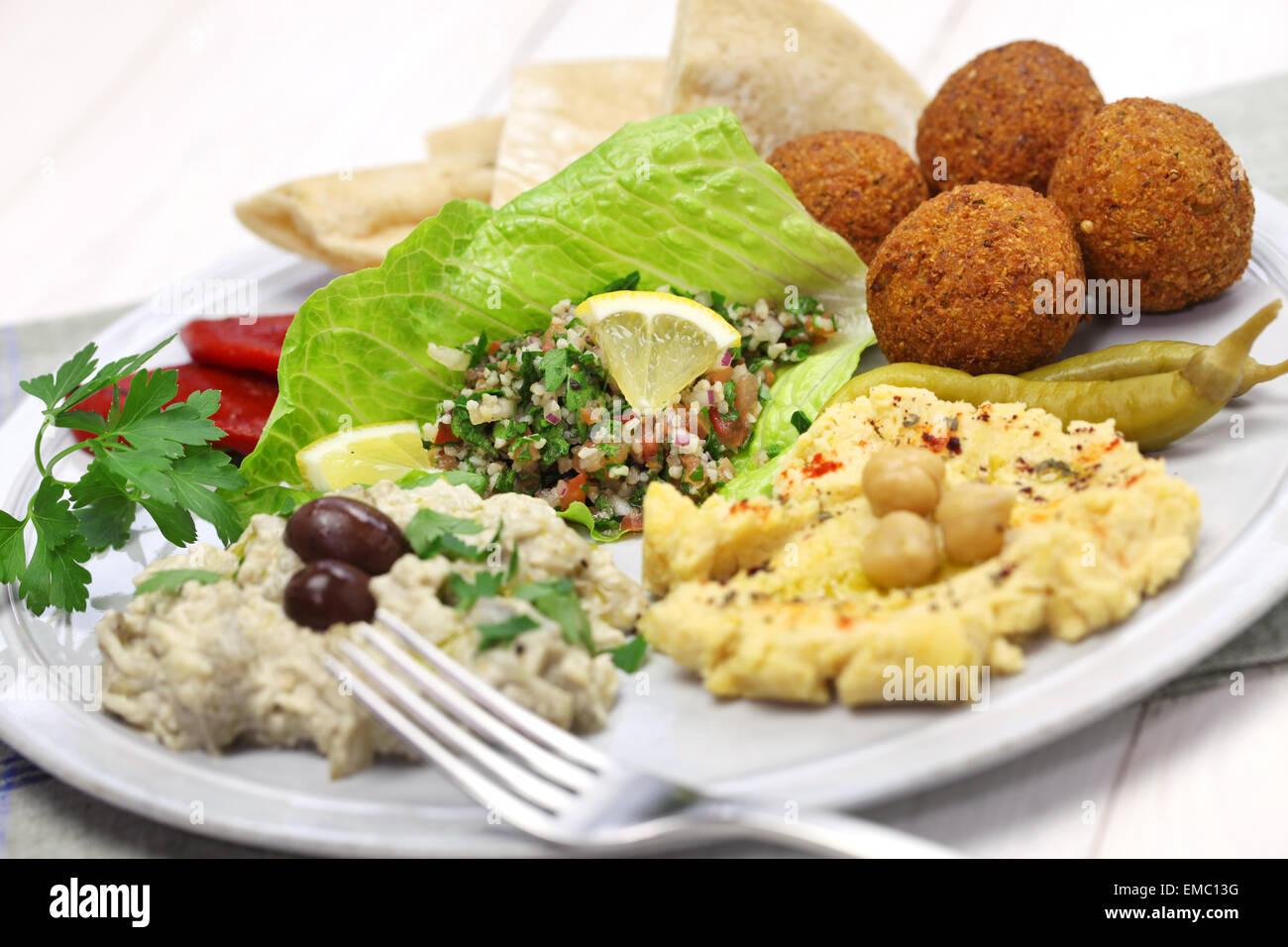 hummus, falafel, baba ghanoush, tabbouleh and pita, middle eastern cuisine - Stock Image