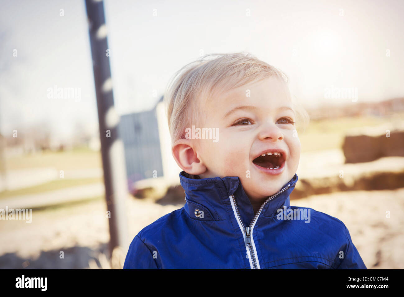 Germany, Oberhausen, toddler with open mouth on playground - Stock Image