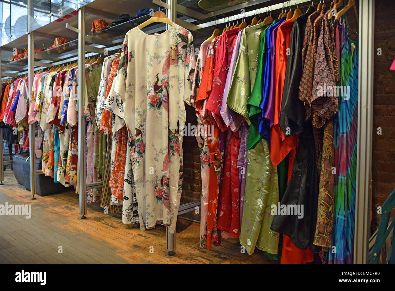 Colorful Chinese women's robes for sale at Pearl River on Broadway in Downtown Manhattan, New York City. - Stock Image