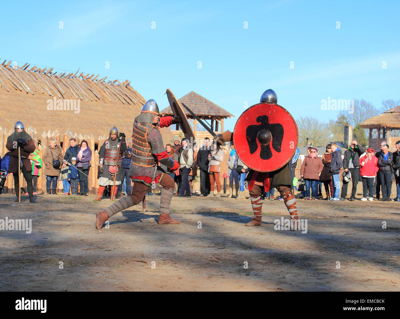 Medieval warriors fighting in acting battle. Slawutowo village, Pomerania region, Poland. - Stock Image
