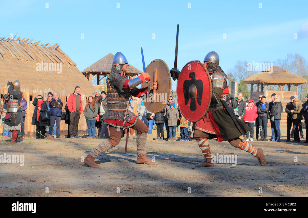 Medieval settlement in Slawutowo. Acting battle with costumed warriors. Pomerania region, Poland. - Stock Image