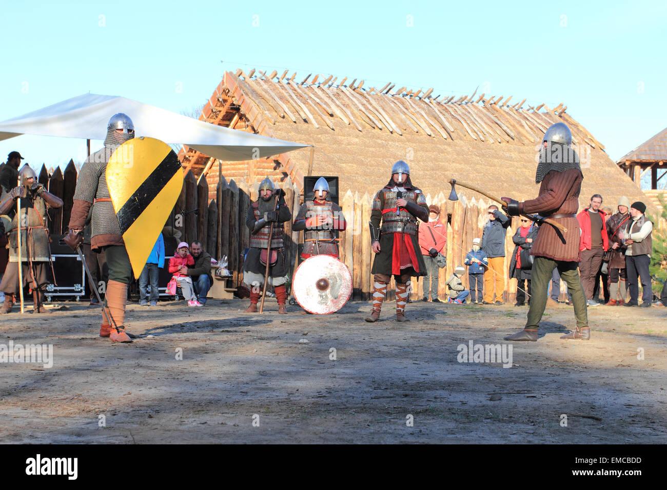 Warriors in medieval costumes in acting battle. Slawutowo village, Pomerania region, Poland - Stock Image