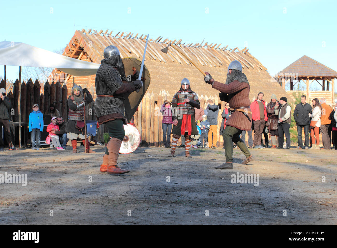 Medieval village in Slawutowo. Warriors fighting in acting battle for tourist attraction. Pomerania region, Poland. - Stock Image
