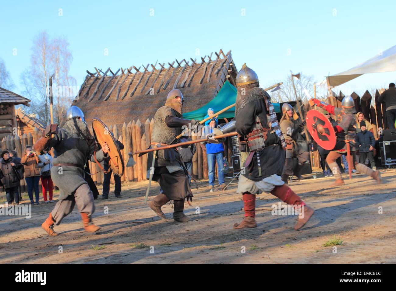 Medieval warriors acting costumed fight for tourist in Slawutowo settlement. Pomerania region, Poland. - Stock Image