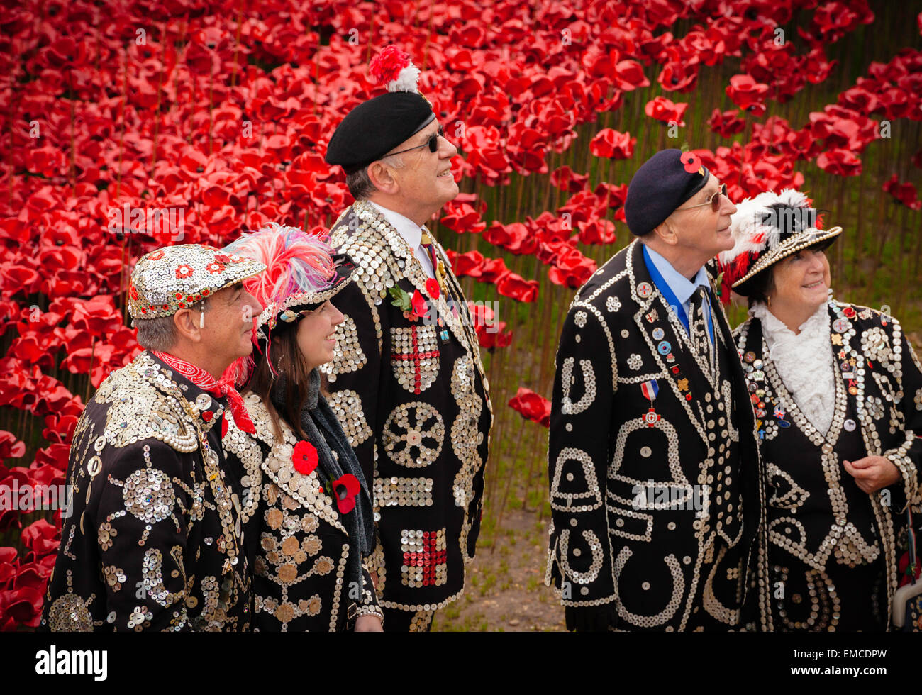 A generation of pearly kings and queens on armistice day at the Tower of London, UK. - Stock Image