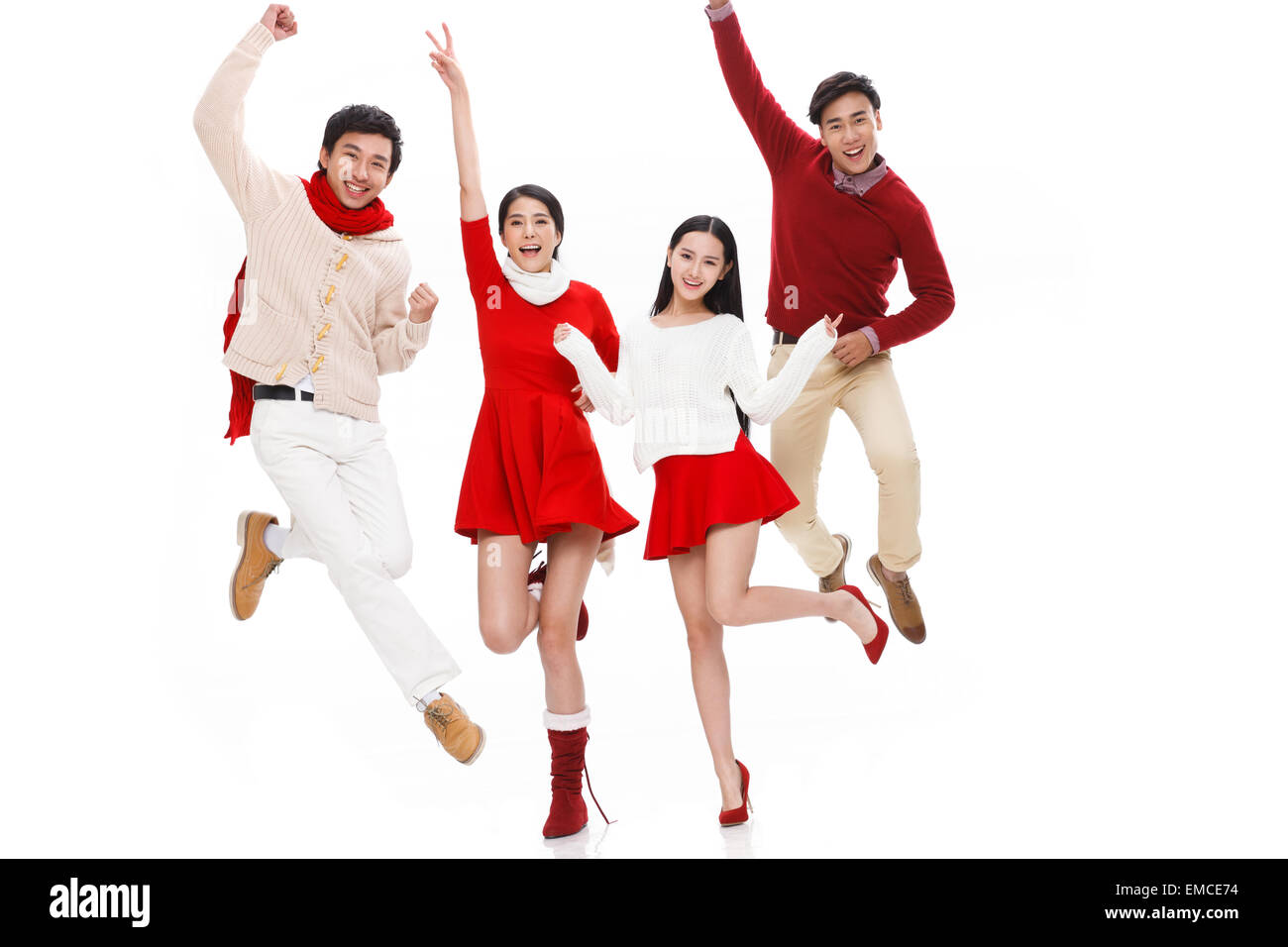 Youthful vitality of the young men and women jump - Stock Image