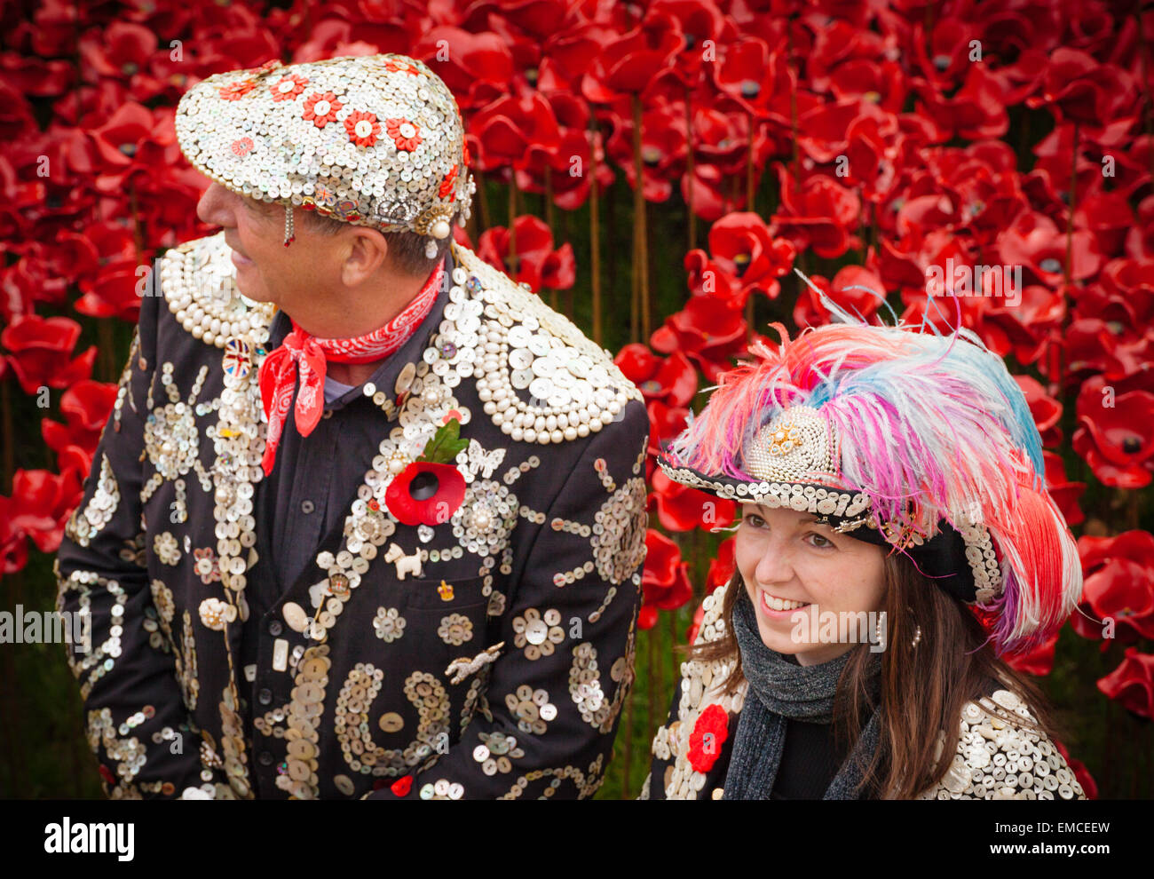 Pearly king and queen or pearly royals on armistice day at the tower of London, UK. - Stock Image