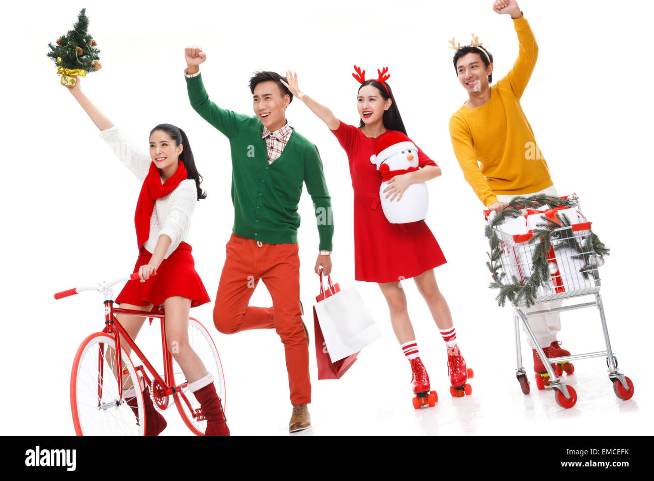 Young people Christmas shopping - Stock Image
