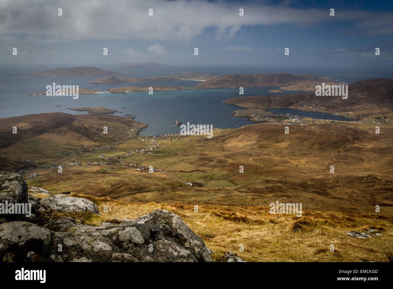 Striking views from the summit of Heaval on the Isle of Barra, looking over Castlebay and Vatersay in the Outer - Stock Image