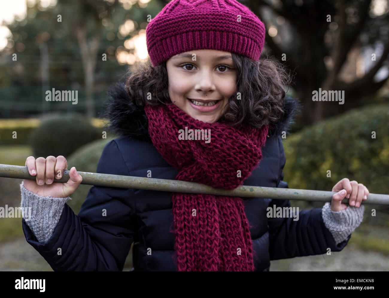 5ae600ca5320 Portrait of smiling little girl wearing wool cap and scarf Stock ...