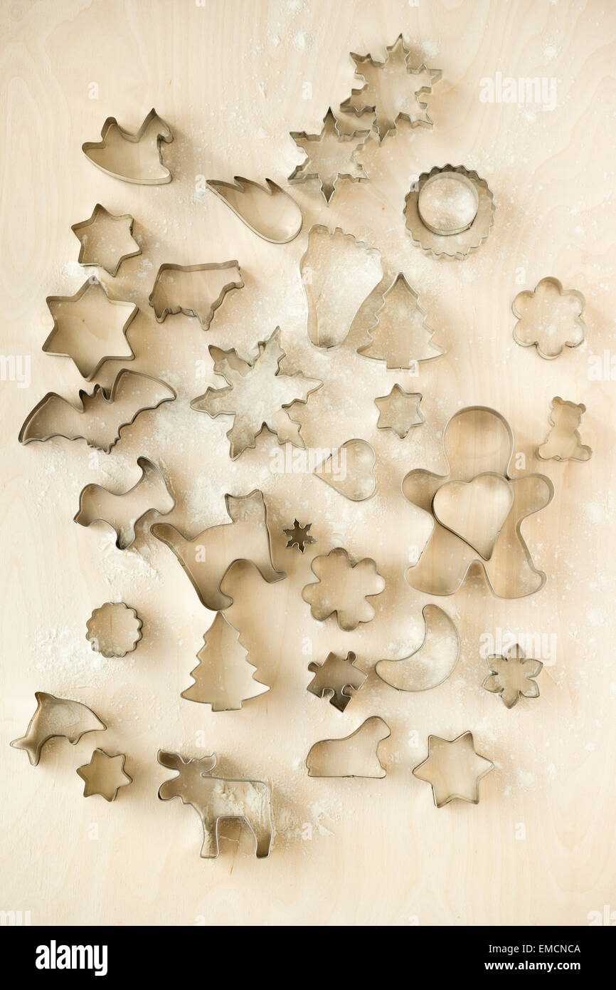 Different cookie cutters on wood - Stock Image