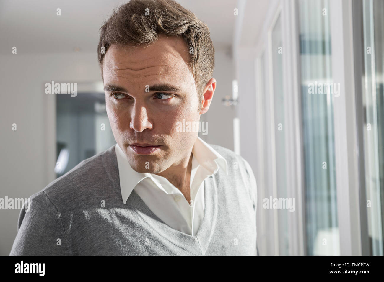 Portrait of man watching something - Stock Image