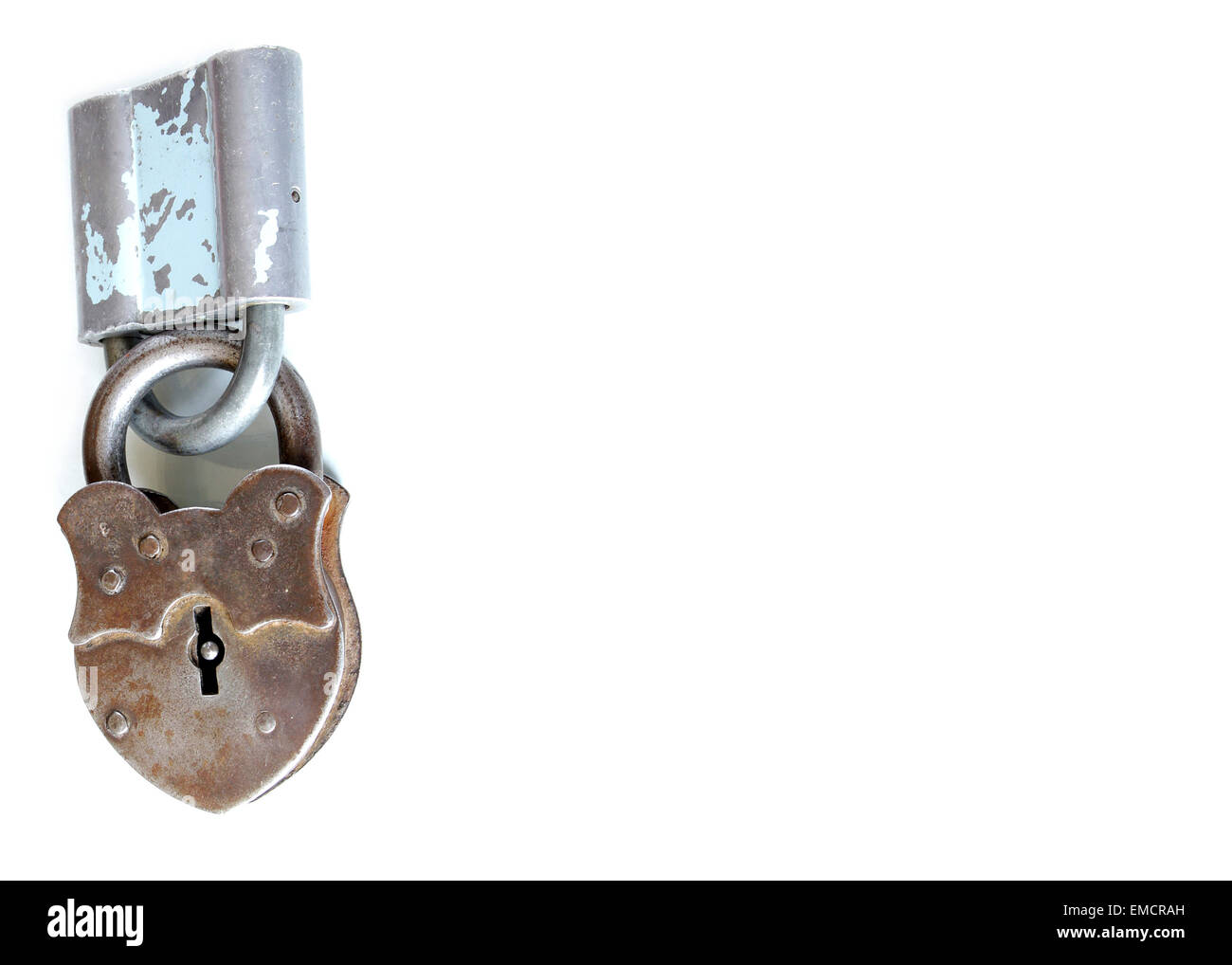 together locked vintage padlocks isolated on white background doing teamwork and counting on each other Stock Photo