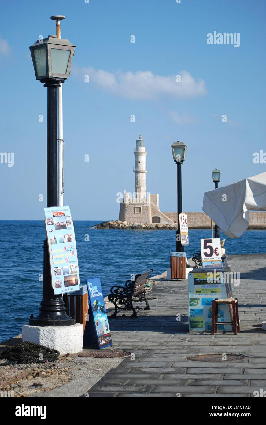 Boat trip promotion posters on the harbour front at Chania, Crete, Greece. - Stock Image