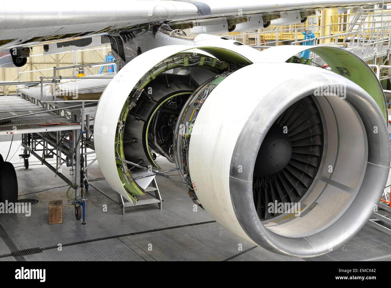 Jet engine of an unfinished airplane in a hangar - Stock Image