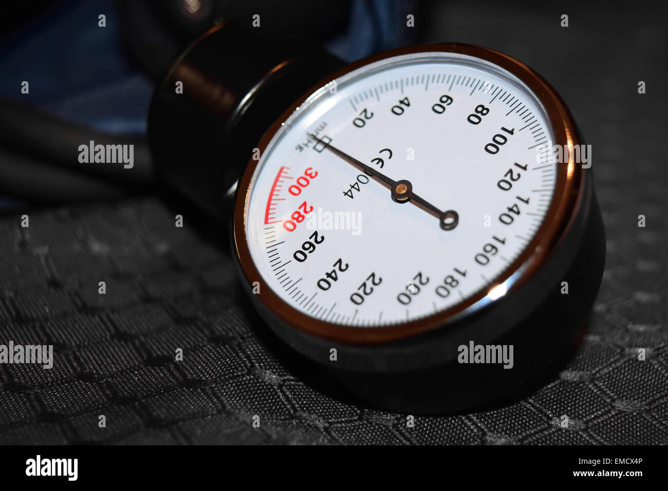 A blood pressure gauge on a blood pressure cuff. - Stock Image