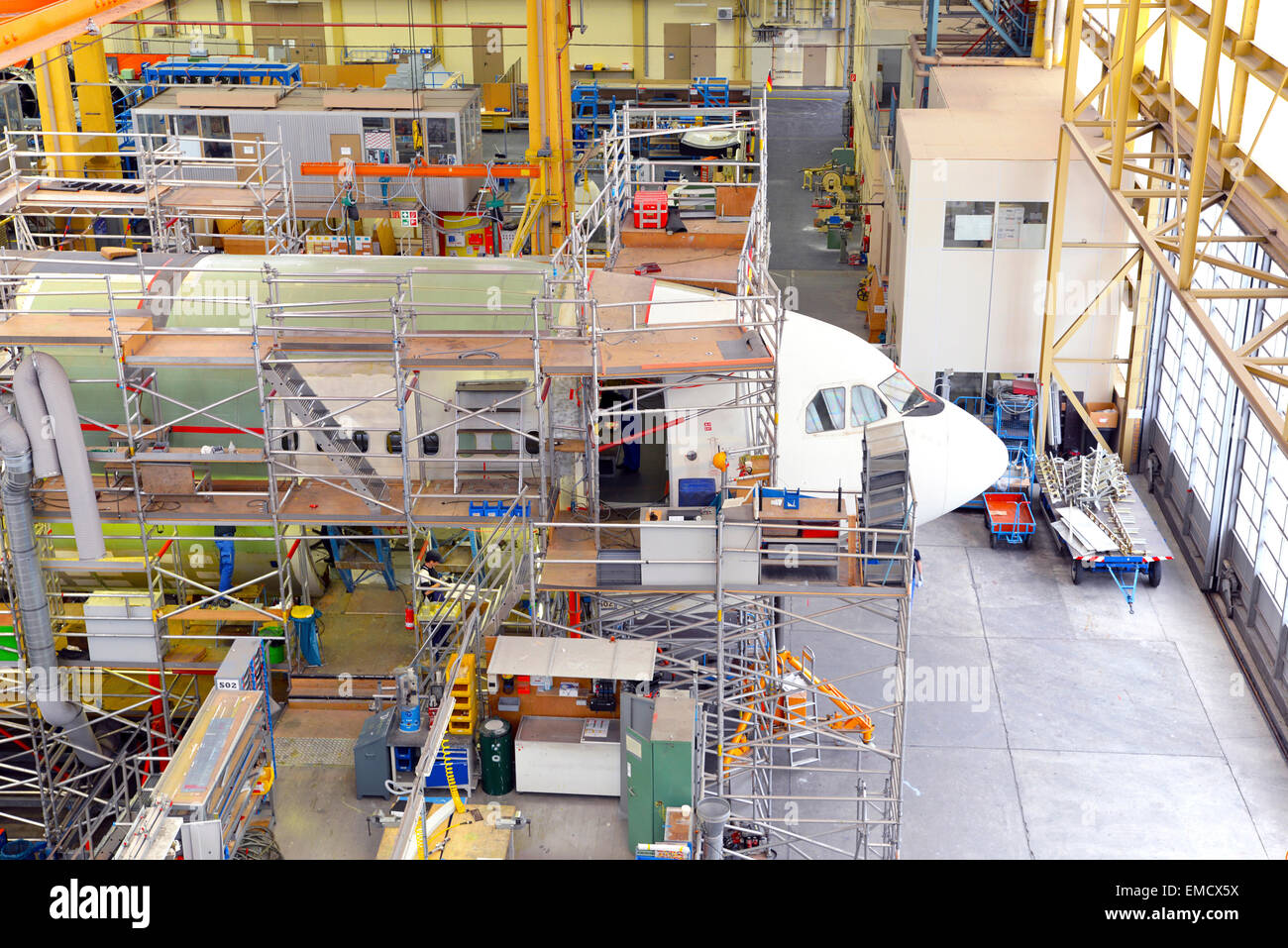 Airplane construction in a hangar Stock Photo