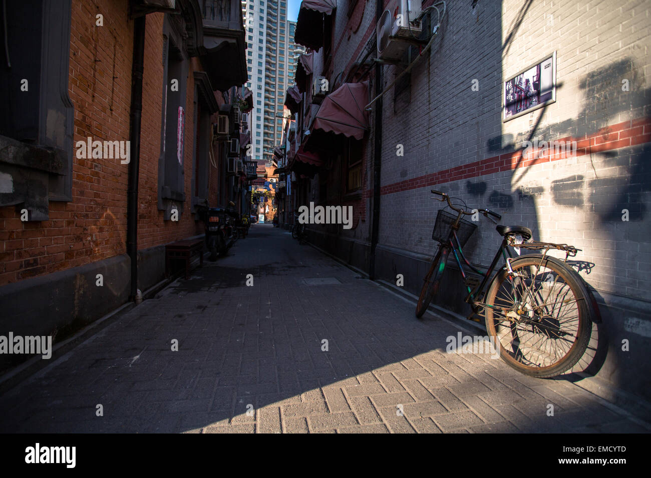 bike on the alley in Shanghai old residential district - Stock Image