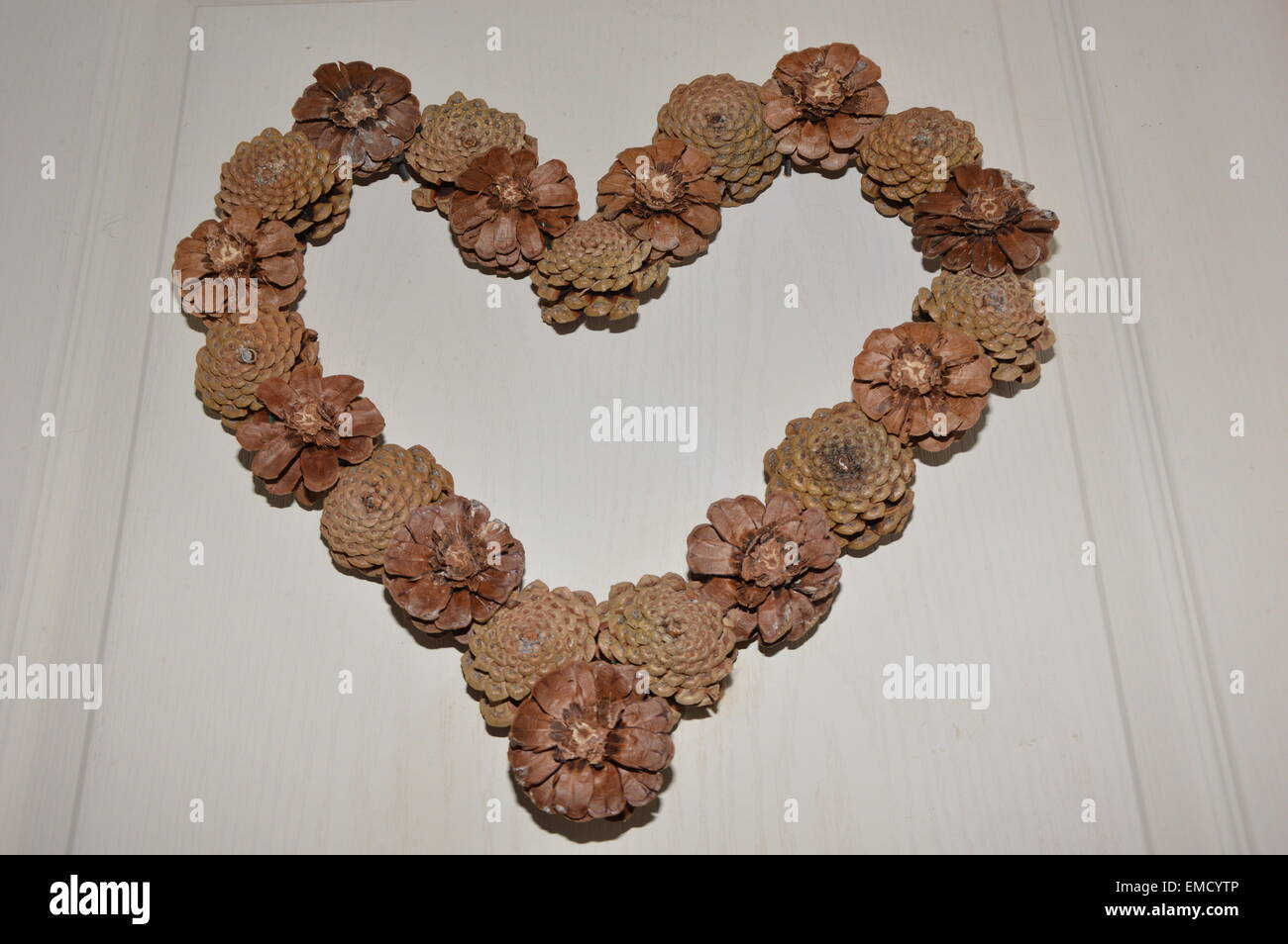 A handcraft heart of love made of  little cones - Stock Image