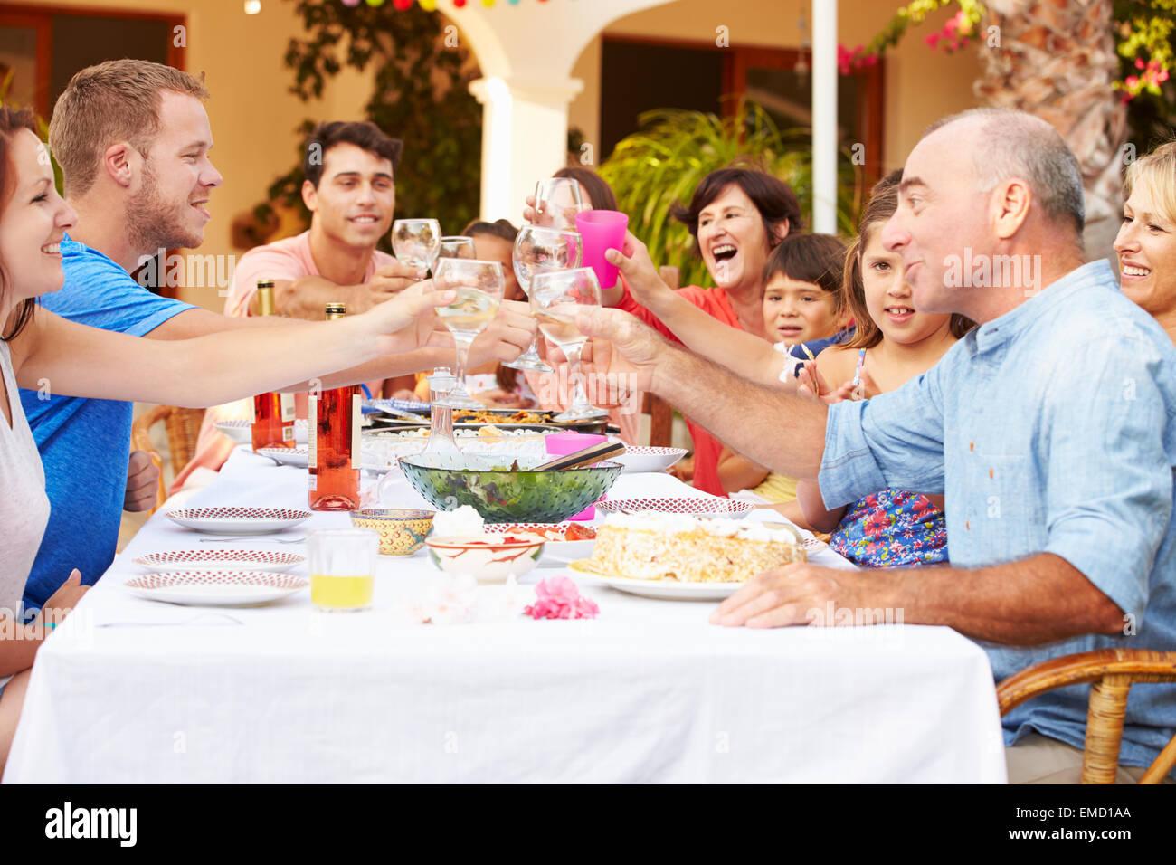 Large Family Group Celebrating Birthday On Terrace Together - Stock Image