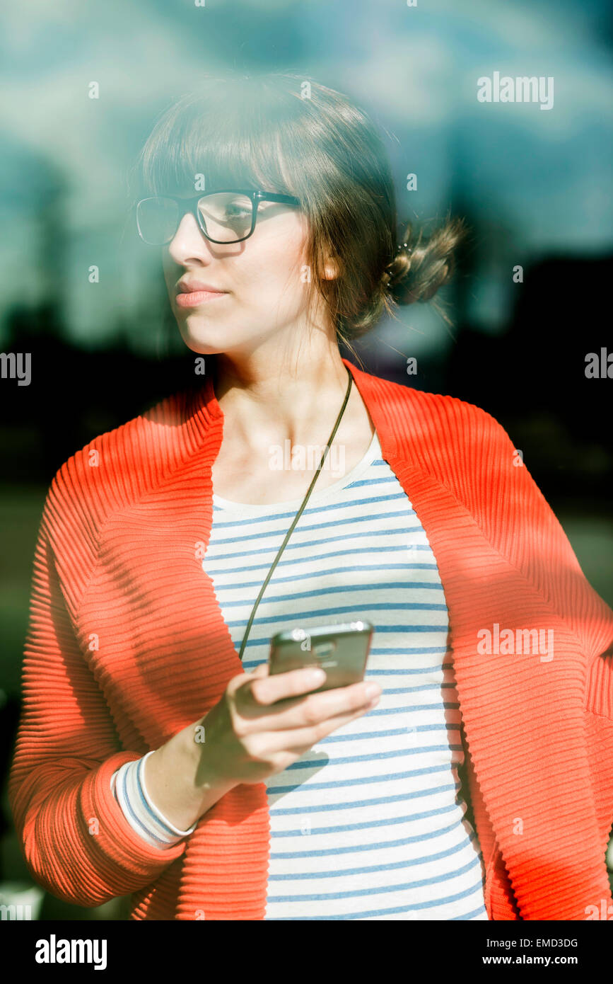 Young businesswoman using moblie phone Stock Photo