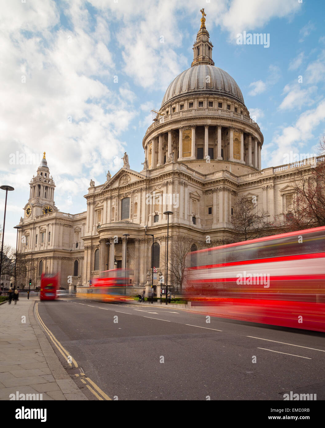 St Paul's Cathedral and Traffic during the day showing double decker buses on the road - Stock Image