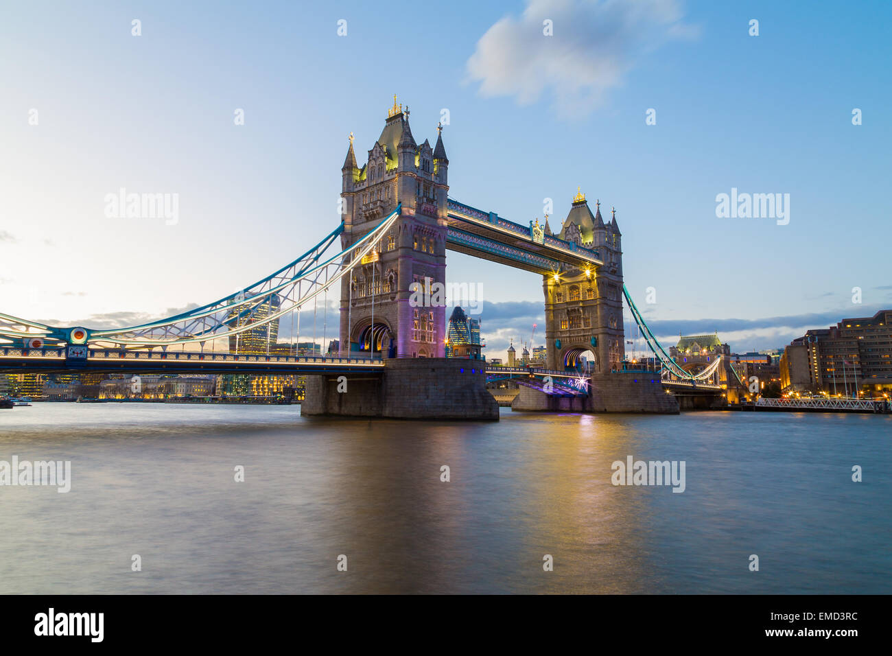 A view of Tower Bridge at Dusk. Buildings from the City of London can be seen in the background. Copyspace can be - Stock Image