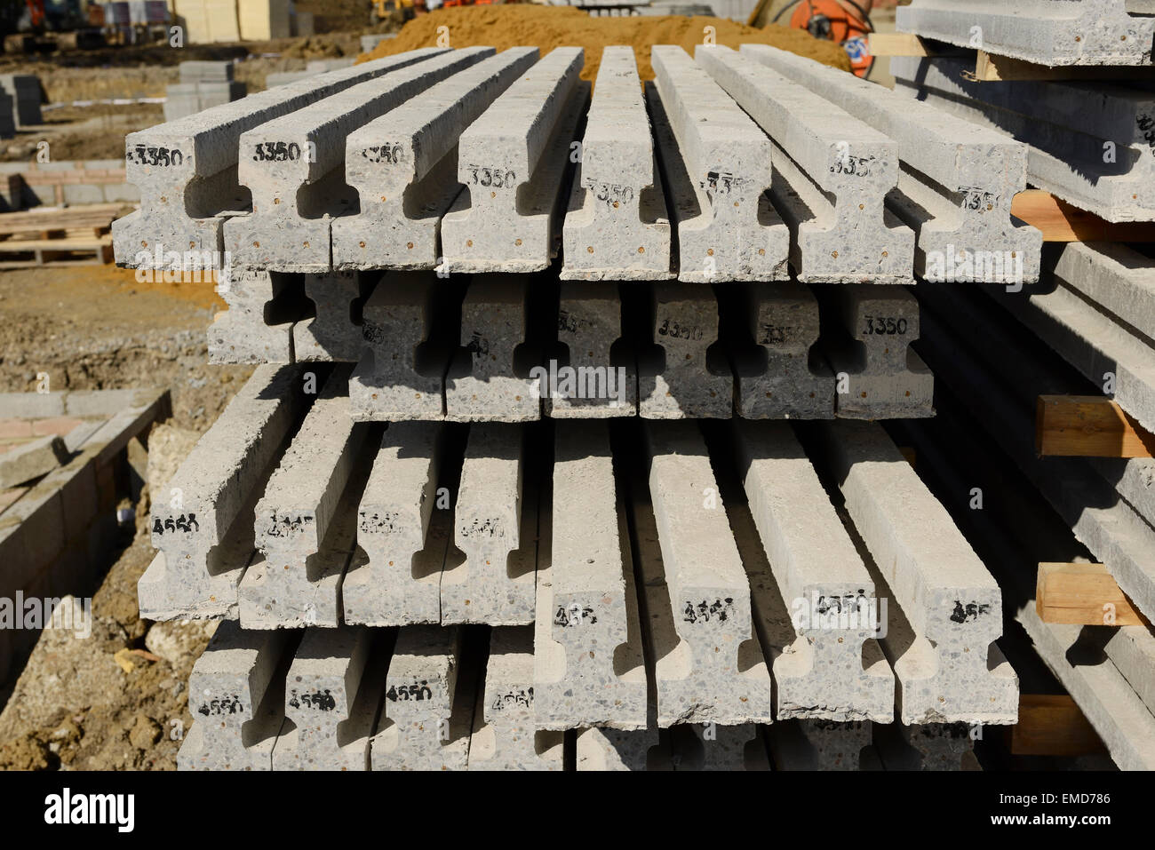 Reinforced concrete beams for a beam and block floor on a UK construction site - Stock Image