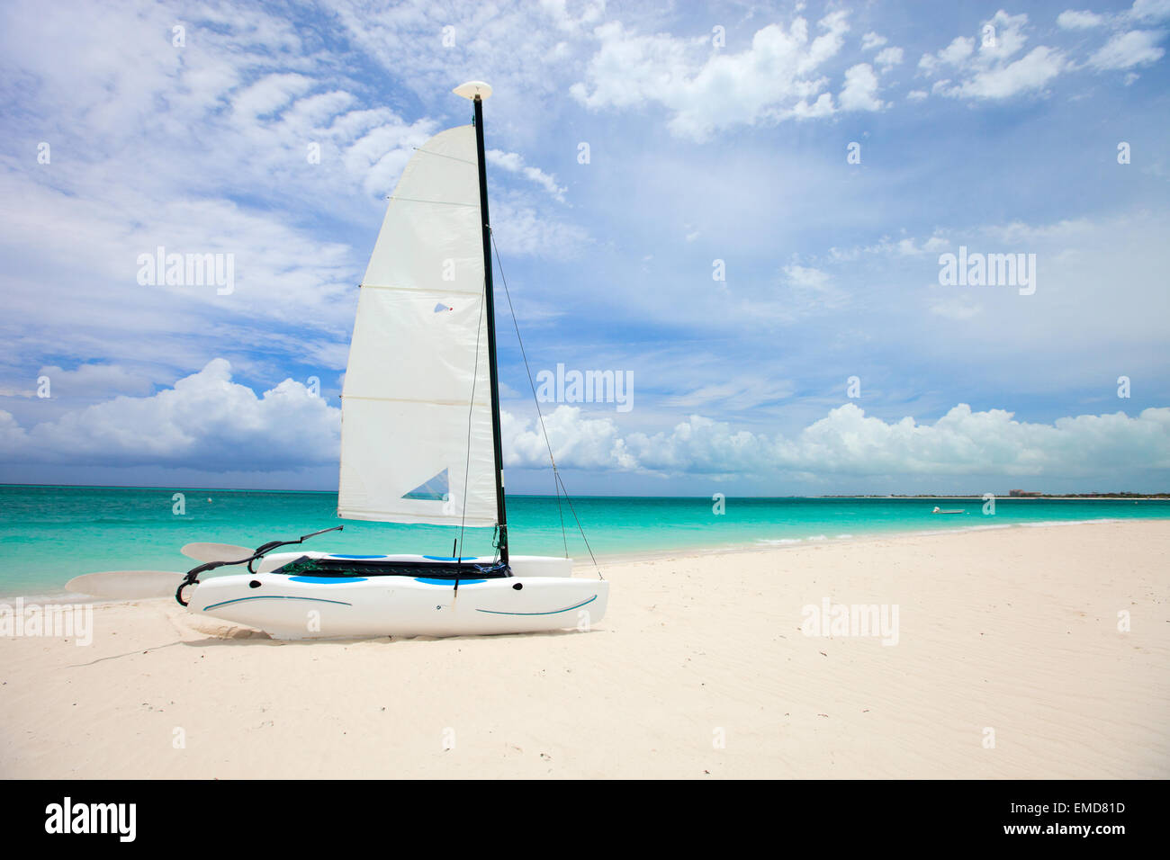 Catamaran at tropical beach - Stock Image