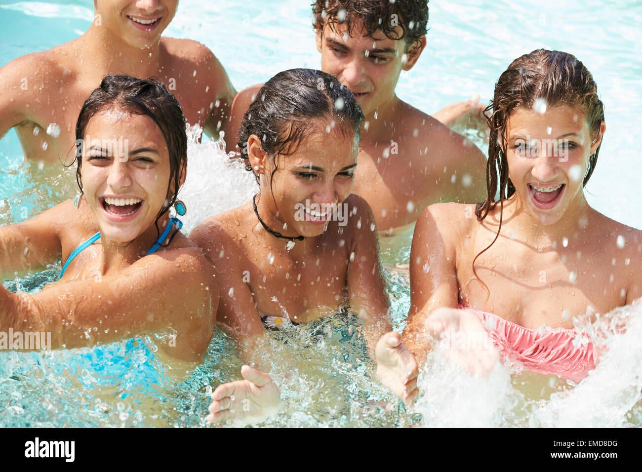 Group Of Teenage Friends Having Fun In Swimming Pool - Stock Image
