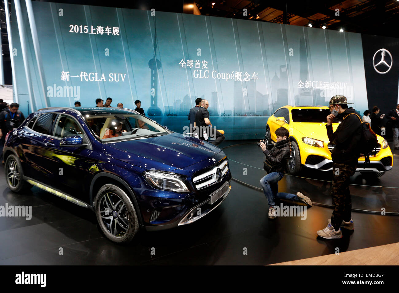 Shanghai, China. 20th Apr, 2015. Visitors look at vehicles of Benz displayed in the Auto Shanghai 2015, east China's Stock Photo