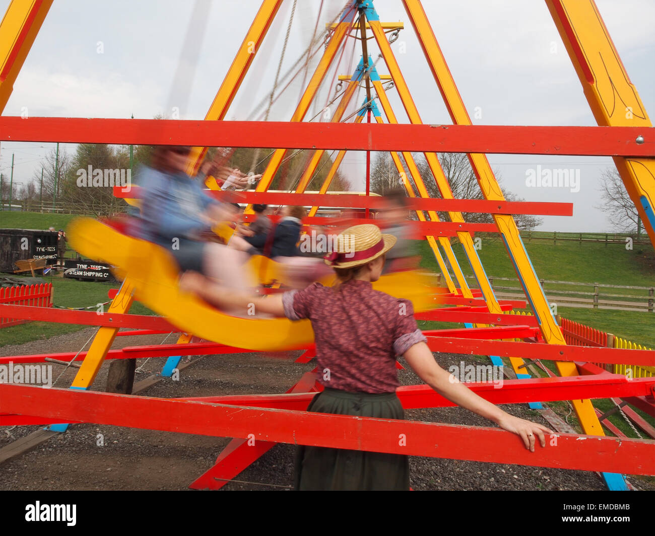 Old fashioned fairground swings at Beamish Open Air Museum in Co. Durham, England. - Stock Image