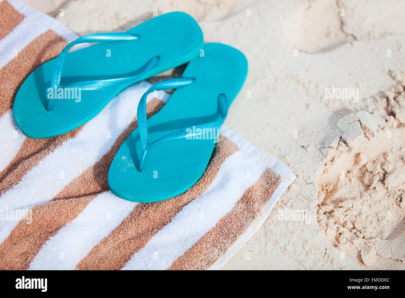 Flip flops at beach - Stock Image