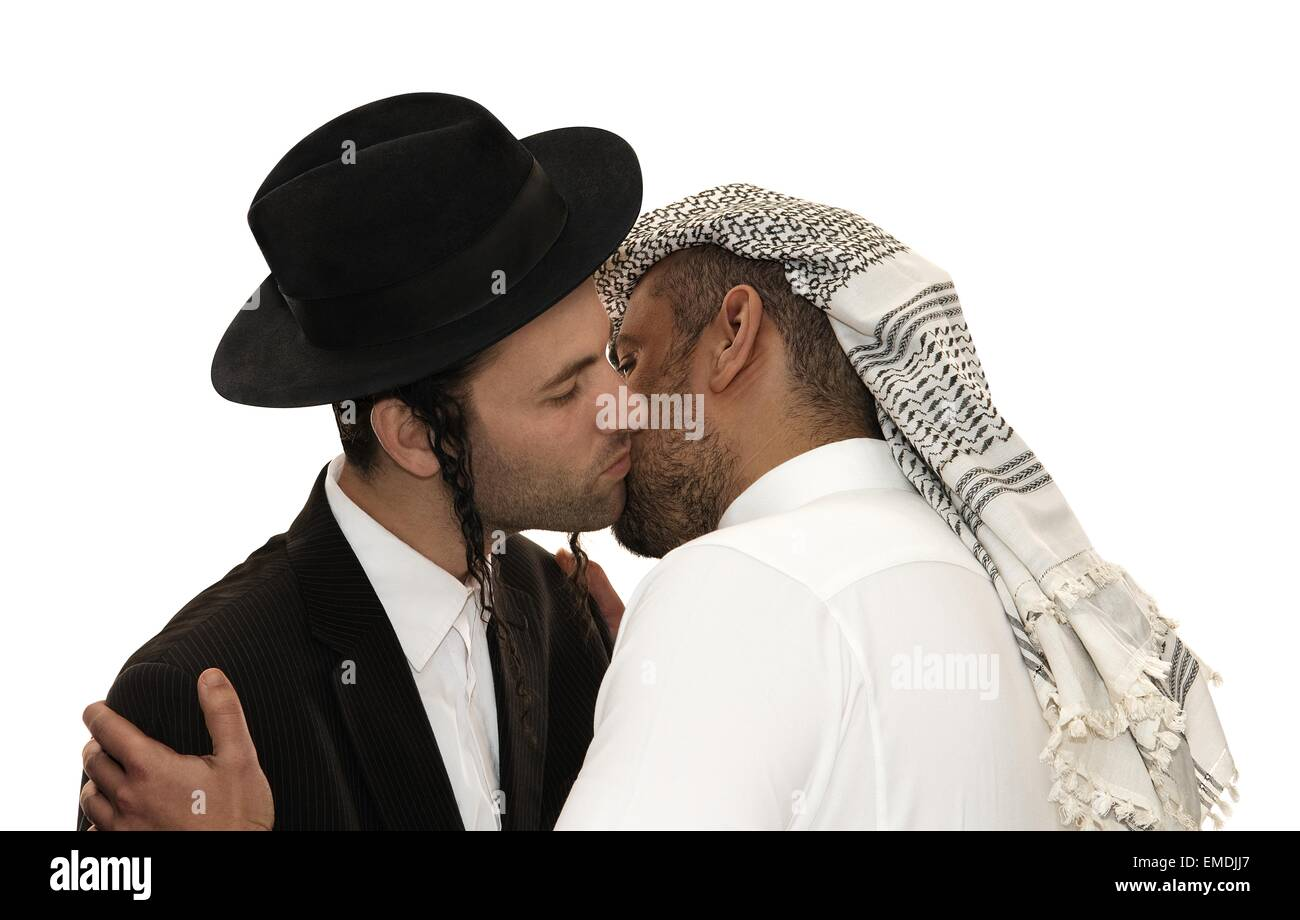 Jew and Arab kissing - Stock Image