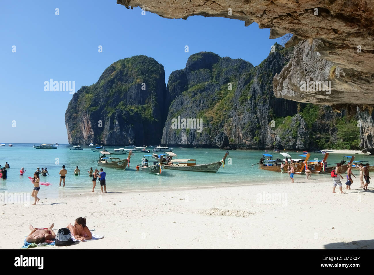 Boats, tourists, sand and sea on tropical Maya Beach, Koh Phi Phi Leh, looking out to the Andaman Sea, Krabi Province, - Stock Image