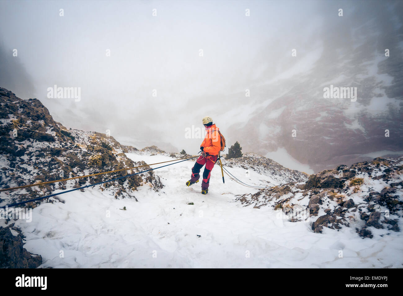 Mountaineer rappelling. - Stock Image