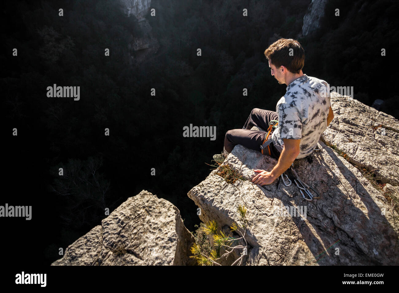 Man on the edge of a cliff - Stock Image